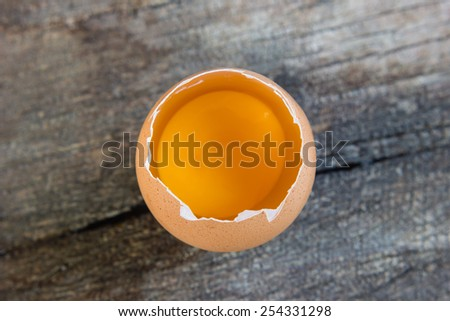 raw eggs on wood background - stock photo