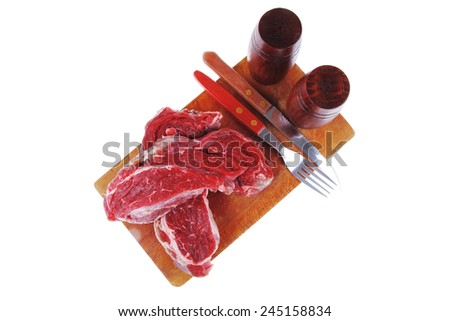 raw fillet mignon on cutting board prepared for roasting - stock photo