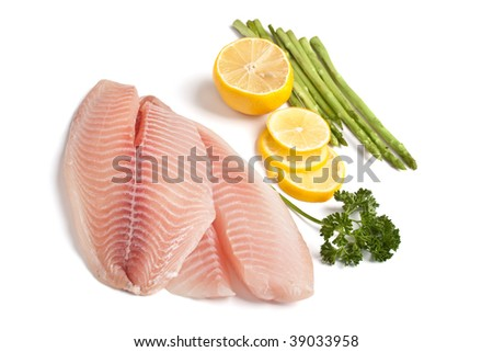Raw Filleted Fish with Asparagus, Parsley and Lemon on White - stock photo