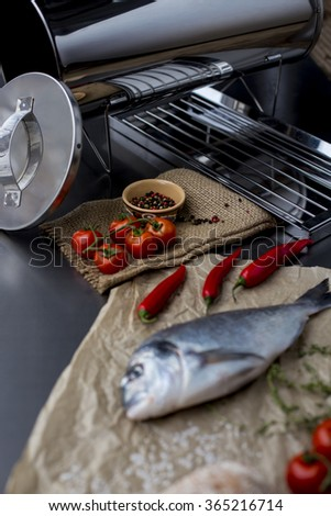 Raw fish dorado on the table before cooking. The ingredients for the grill - stock photo