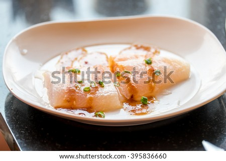 Raw fish in white plate