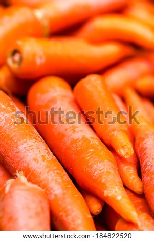 Raw fresh carrots close up. Carrot background. Food background. - stock photo