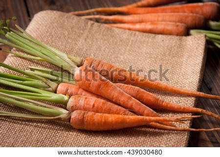 raw fresh carrots on sack