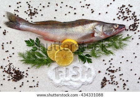 """raw fresh fish on marble table with lemon, pepper, dill and parsley. Pile of salt with word """"fish"""". zander fish. top view, flat lay. - stock photo"""