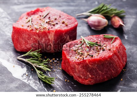 Raw fresh marbled meat Steak and seasonings on dark marble background close-up - stock photo