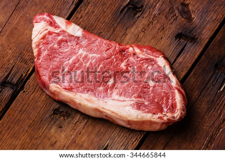 Raw fresh meat Striploin steak on wooden background
