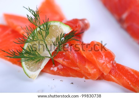 Raw fresh red salmon at white plate