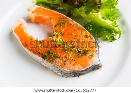 Raw fresh Salmon steak in plate  with vegetables