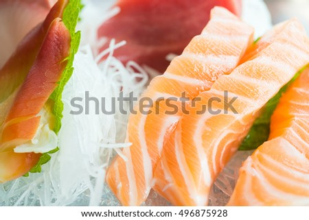 Raw fresh sashimi with salmon , tuna , and other fish - Japanese food style
