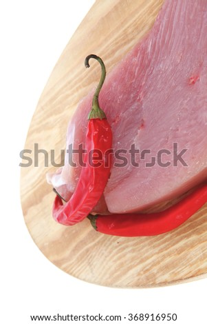 raw fresh turkey meat steak fillet cuts on wooden board with red hot chili pepper isolated over white background - stock photo