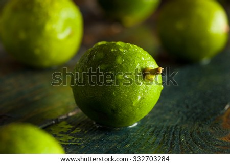 Raw Green Organic Key Limes in a Bowl - stock photo