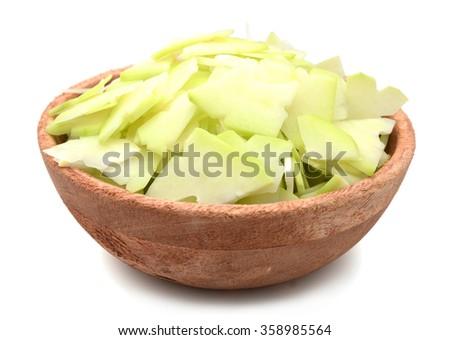 Raw green papaya cut in bowl - stock photo