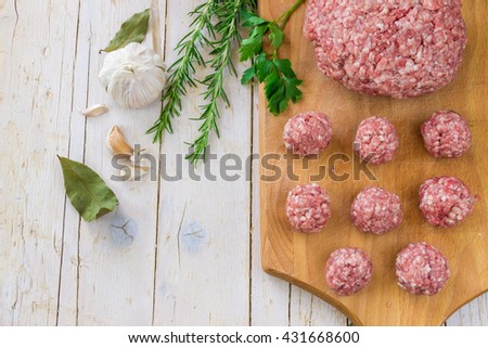 Raw ground beef meat steak cutlets with herbs and spices on white table or board for background. Healthy eating - stock photo