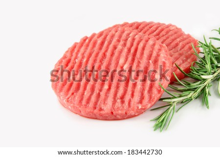 Raw hamburger meat, and  rosemary - stock photo