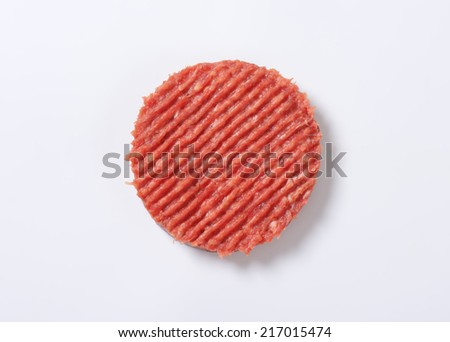 raw hamburger patty on white background - stock photo