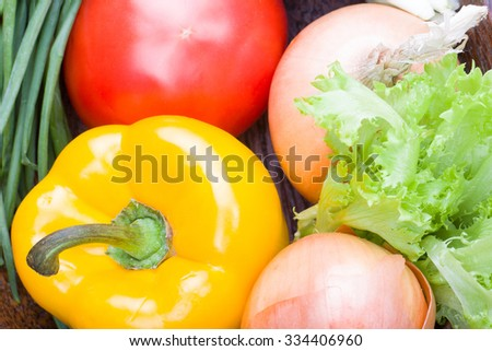 raw health vegetables on wooden kitchen table - stock photo