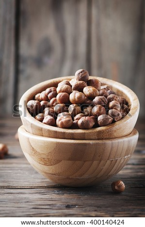 Raw healthy hazelnut on the wooden table, selective focus