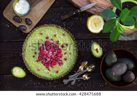 Raw Healthy Paleo Avocado Lemon Cake with Banana and Raspberries, Top View - stock photo
