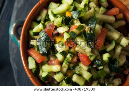 Raw Homemade Cucumber Pico De Gallo Salsa with Chips - stock photo