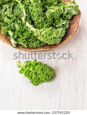 raw  kale preparation on white wooden table - stock photo