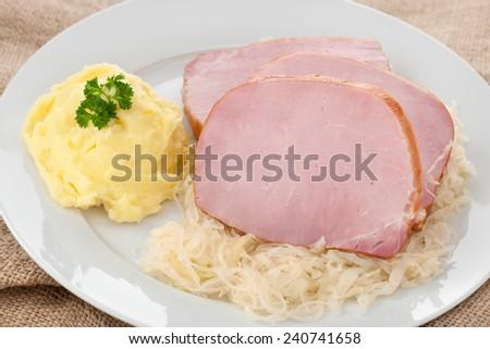 Raw kasseler and sauerkraut, an classic German cuisine - stock photo
