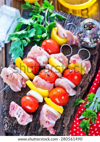 raw kebab on board and on a table - stock photo