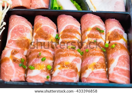 Raw kurobuta pork slices on plates, for sukoyaki and yakiniku hot pot shabu, japanese food. shallow DOF - stock photo