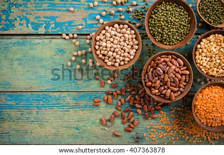 Raw legume on old rustic wooden table, close-up. - stock photo