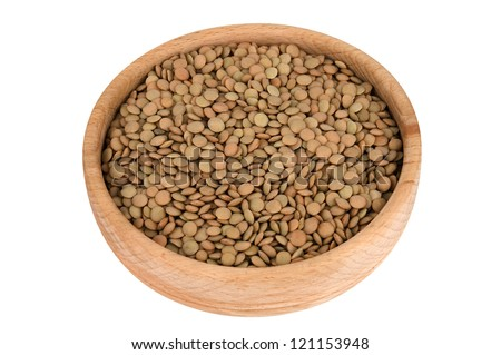 Raw lentils in wooden bowl isolated on white (clipping path) - stock photo