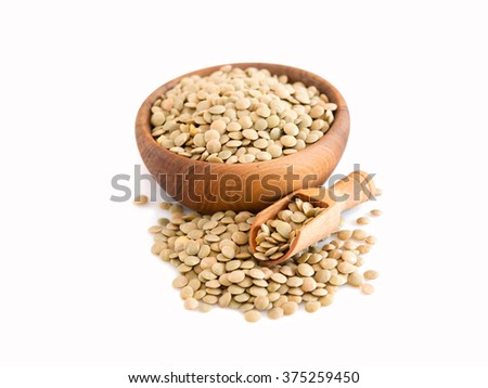 raw lentils on white background