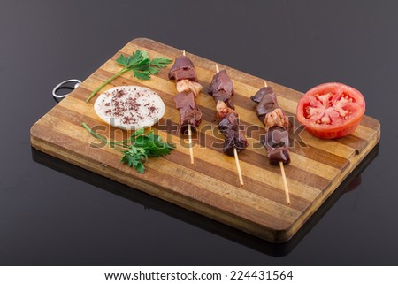 Raw Liver Kebab on a Wood Plate - stock photo