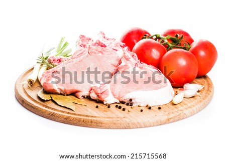 Raw loin slices on the board isolated on white - stock photo