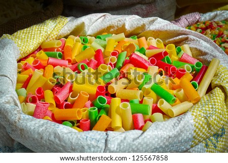 Raw macaroni like pasta for sale in a market in Bikaner, Rajasthan, India - stock photo