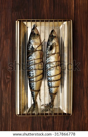 Raw mackerel fish ready for smoke-dried, top view - stock photo
