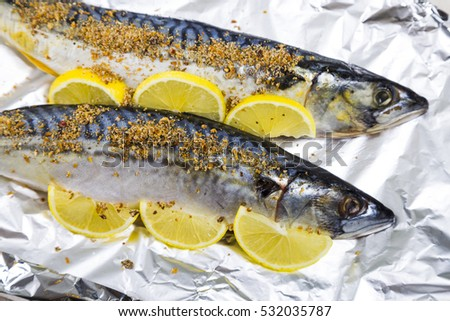 Raw mackerel in foil close up. Preparation of fresh fish.