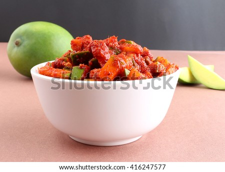 Raw mango pickle in a bowl.