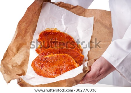 Raw marinated meat for bbq, pork chop - stock photo