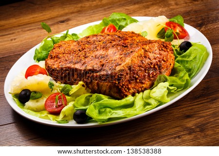 Raw, marinated pork and vegetables - stock photo