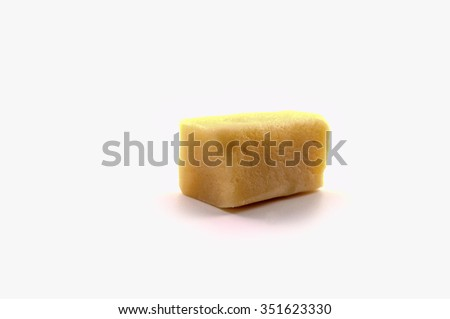 Raw Marzipan block on white background - stock photo