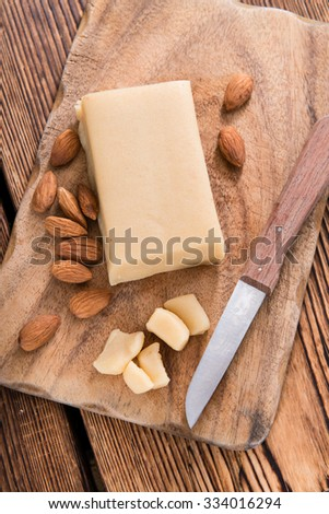 Raw Marzipan (close-up shot) on vintage wooden background - stock photo