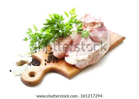 raw meat and spices on wooden cutting board - stock photo