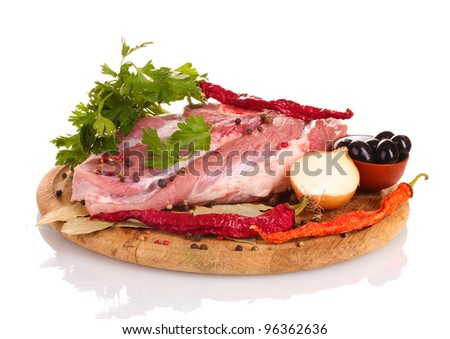 Raw meat and vegetables on a wooden board isolated on whit?