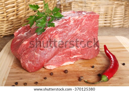 Raw meat Beef, tenderloin, thigh fillet on a board - stock photo