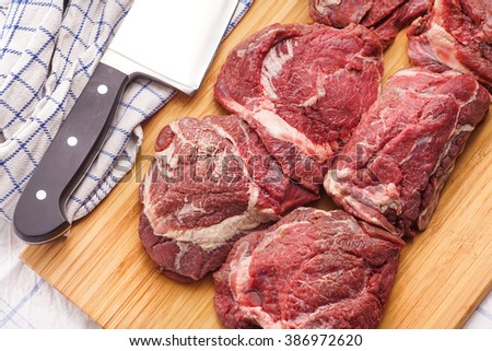 raw meat, delicious veal, Beef Cheeks - best meat for tasteful gourmet slow cooking - stock photo