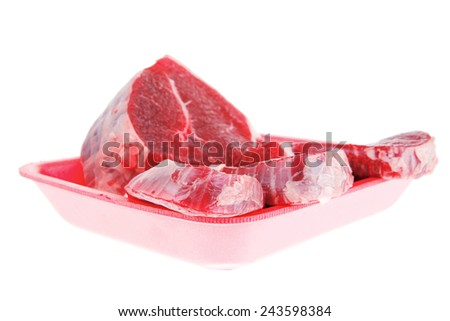 raw meat : fresh beef pork big tenderloin strip on red tray isolated over white background - stock photo