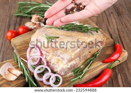 Raw meat on wooden table, close-up - stock photo