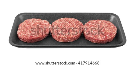 Raw meat patty in package, isolated on white - stock photo