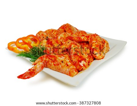 Raw meat. Pork escalope slices with sauce  in a Dish Isolated Against White Background - stock photo