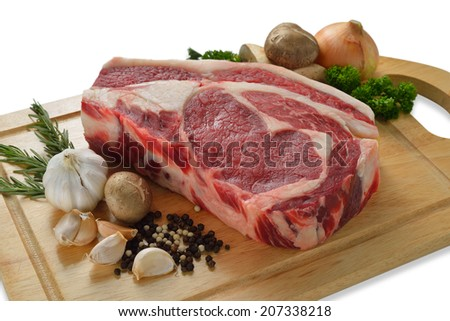 Raw meat ready to be cooked on white background ( rib eye steak ) - stock photo