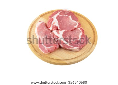 Raw meat steaks on wooden board, isolated on white background - stock photo